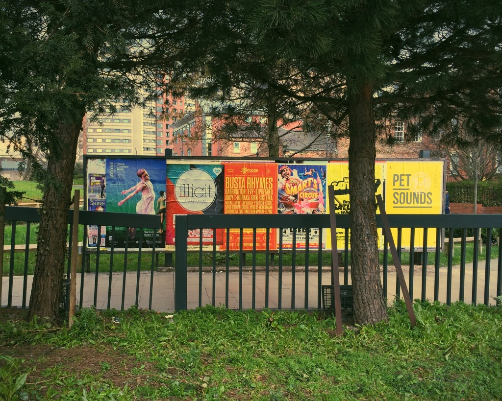 Posters beneath the trees