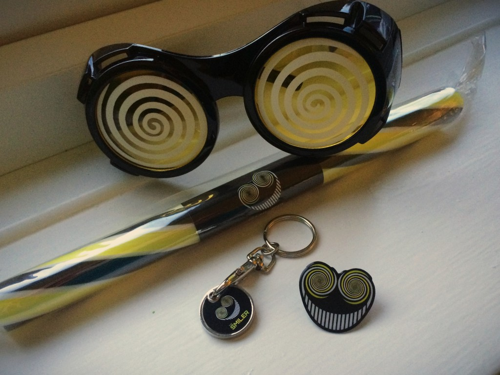 The Smiler glasses, rock, pin and trolley coin