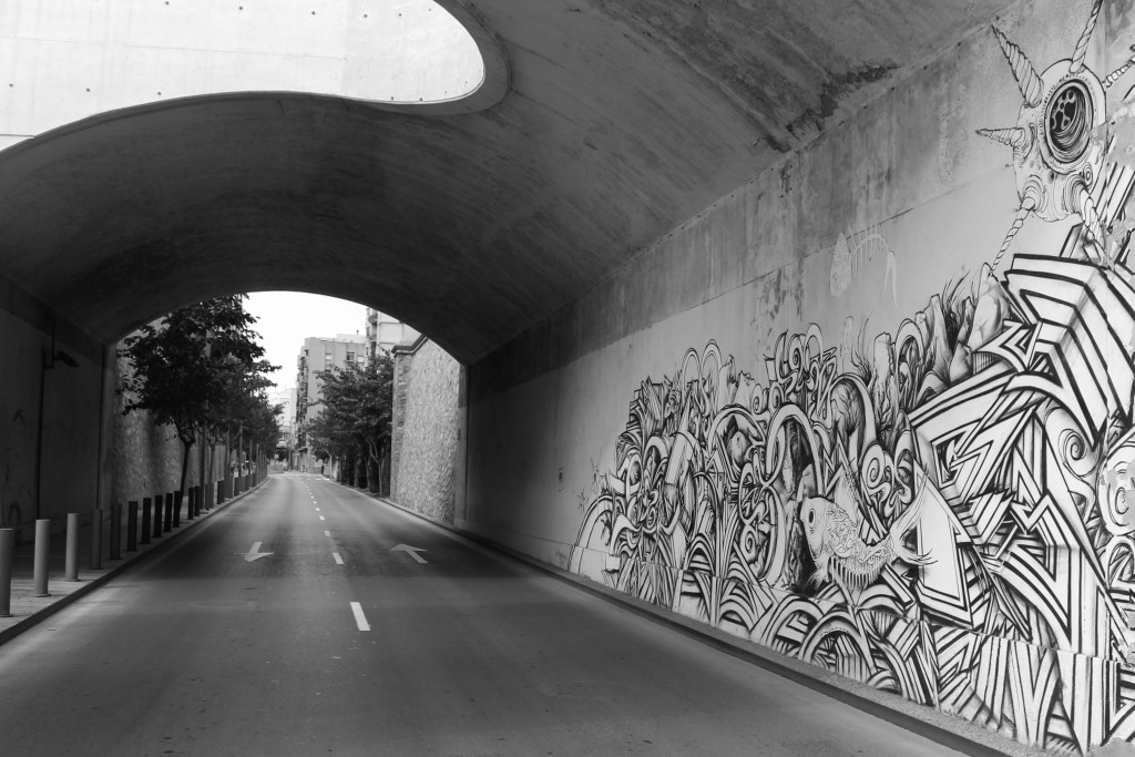 An underpass with graffiti