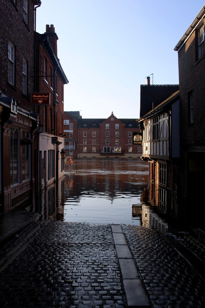 A street disappears into the water