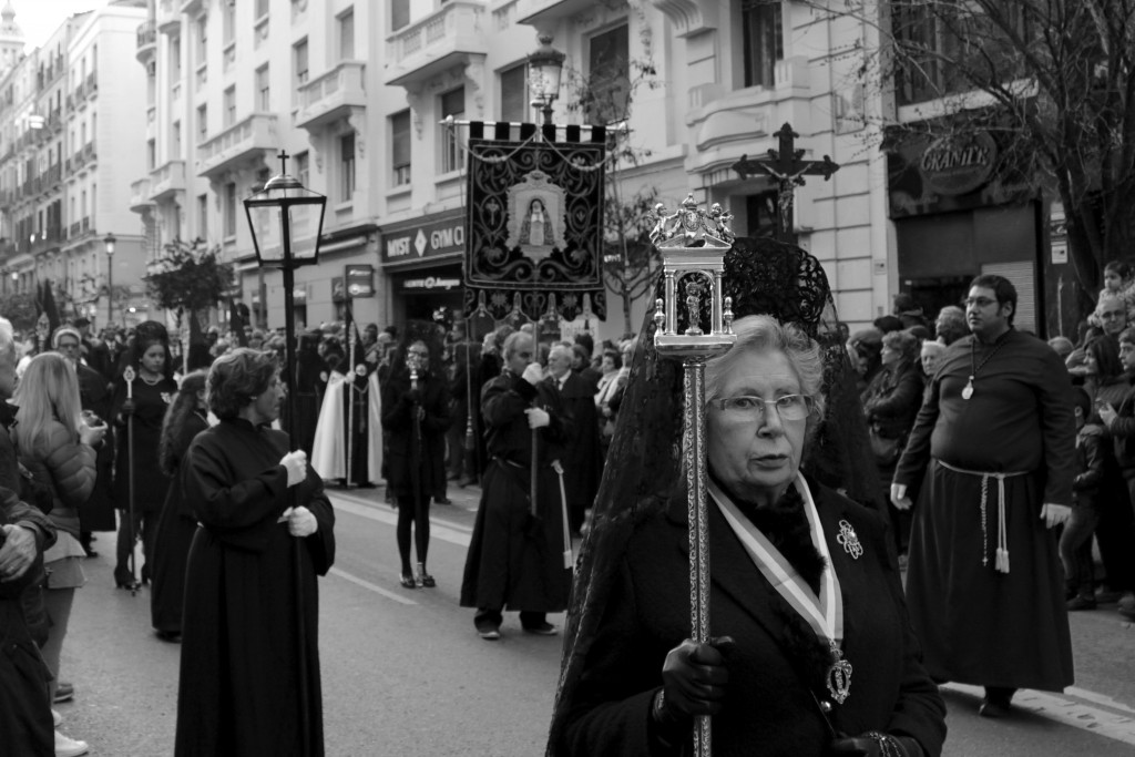 Mourners and banners accompany the images