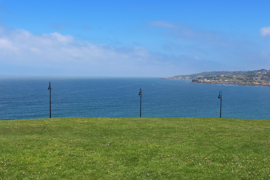 Three lamp posts and the sea