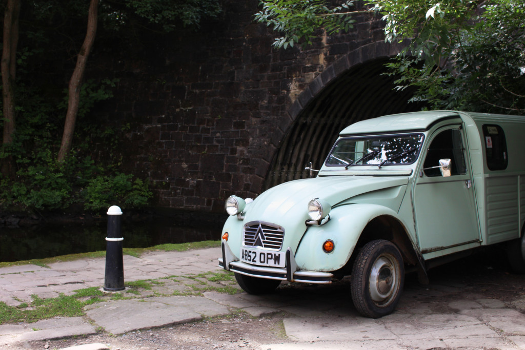 A vintage car by the canal