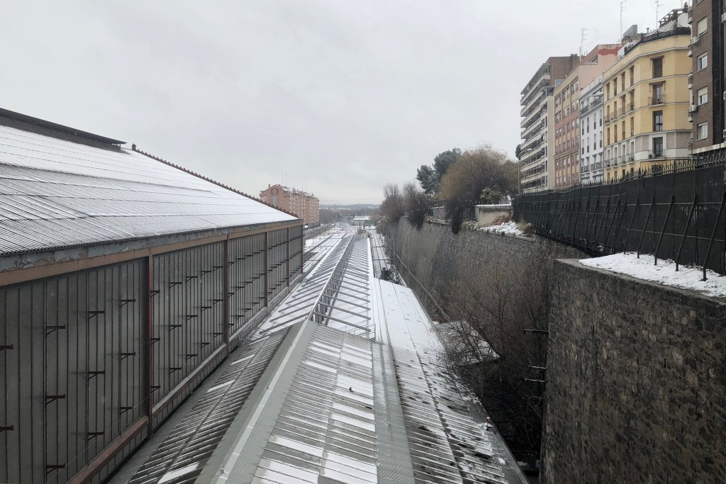 The train station is topped with snow