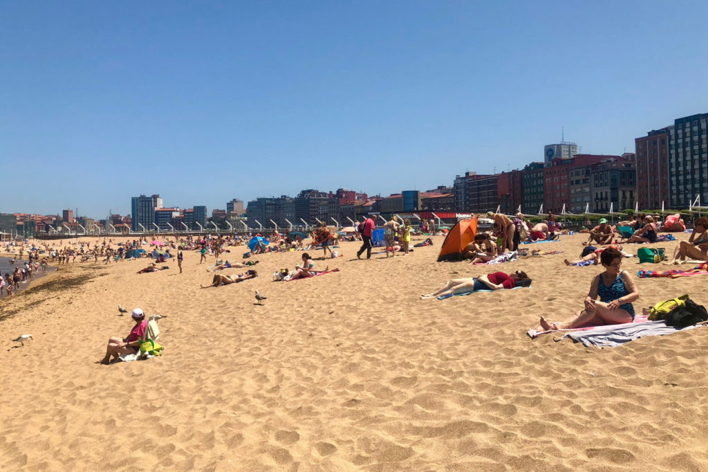 Relaxing on a beach in Gijón