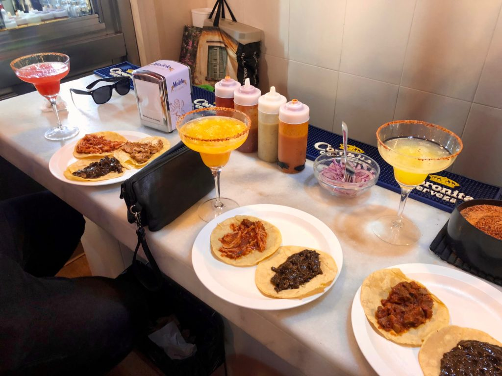 A selection of tacos and margaritas