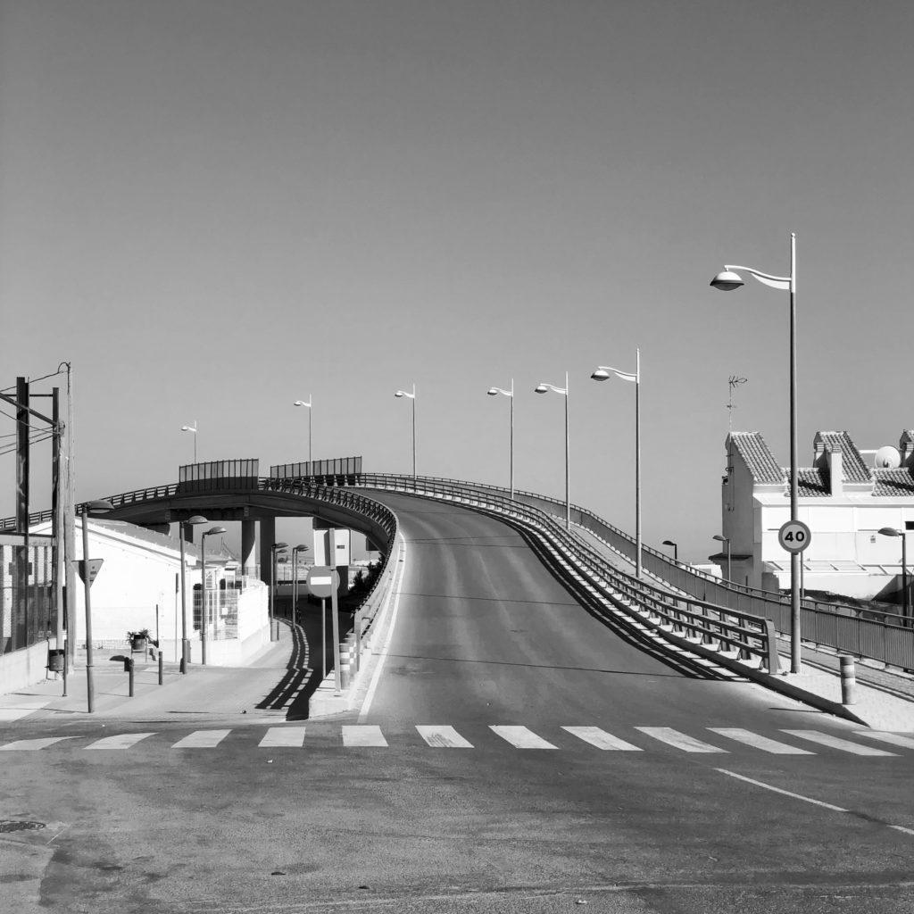 A bridge flies over the railway line