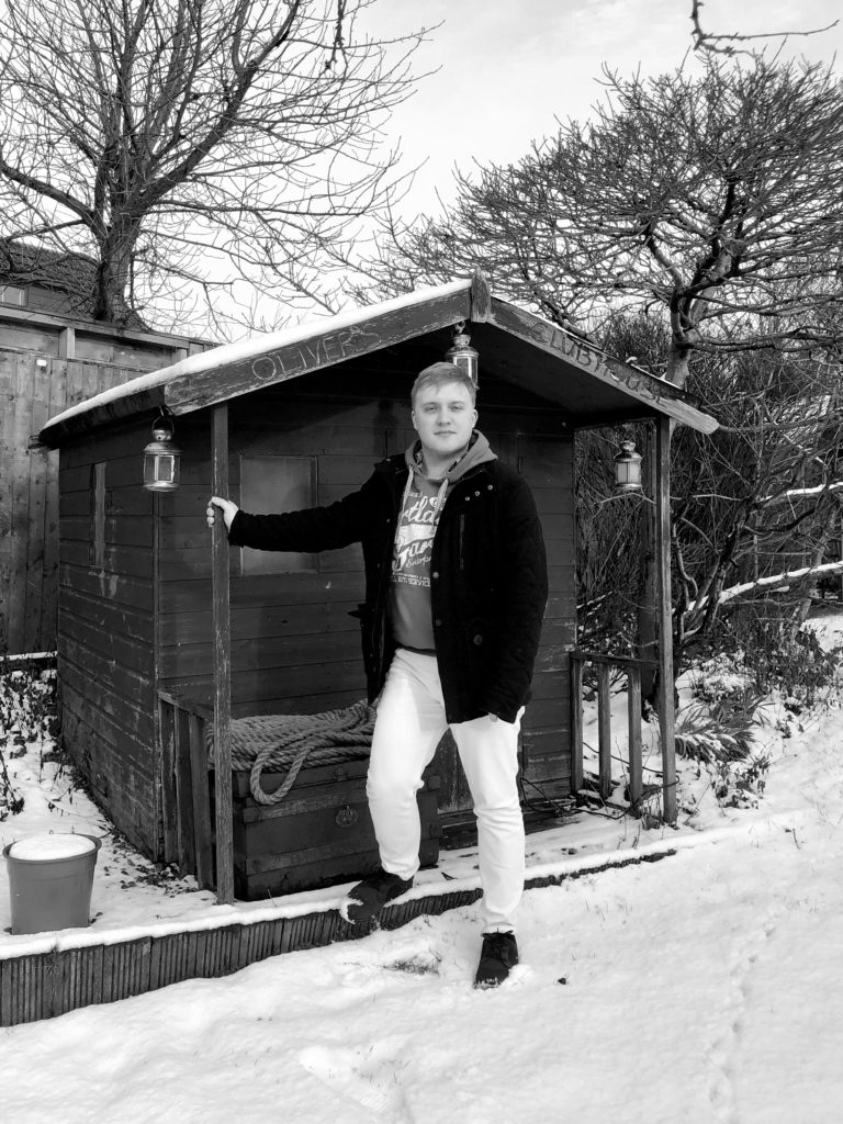Me, stood outside of my shed. There is snow on the ground.
