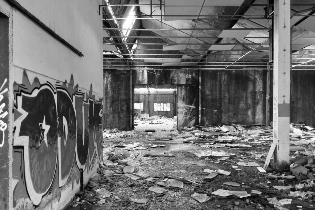 The interior of an abandoned factory.