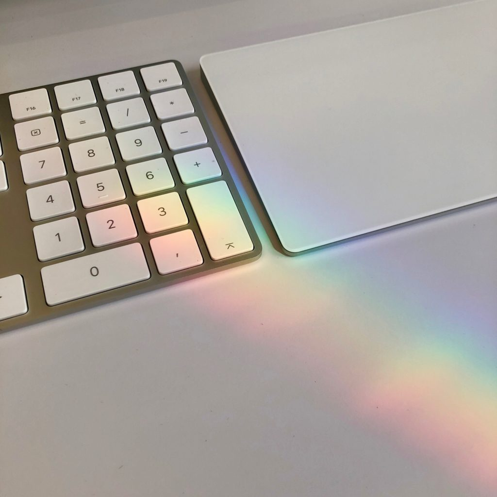 A rainbow is formed over my keyboard at work.