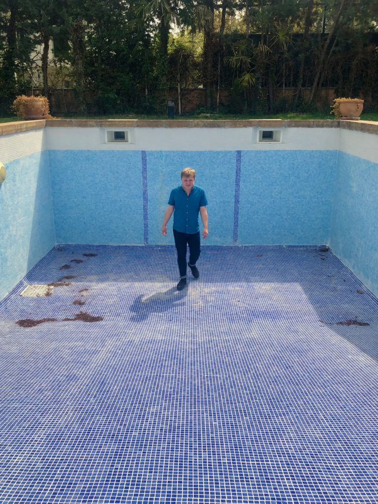 I stand in a dry pool.