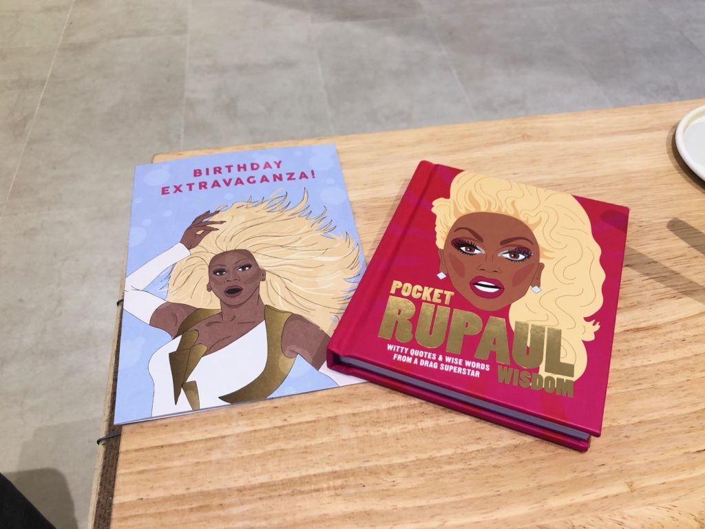 A Ru Paul card and Ru Paul Pocket Wisdom book.