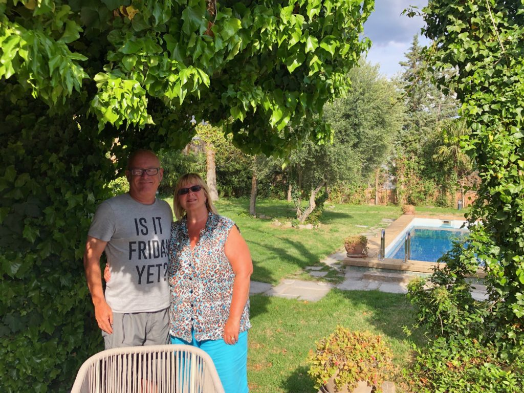 My auntie and uncle stood in the garden of my new office.