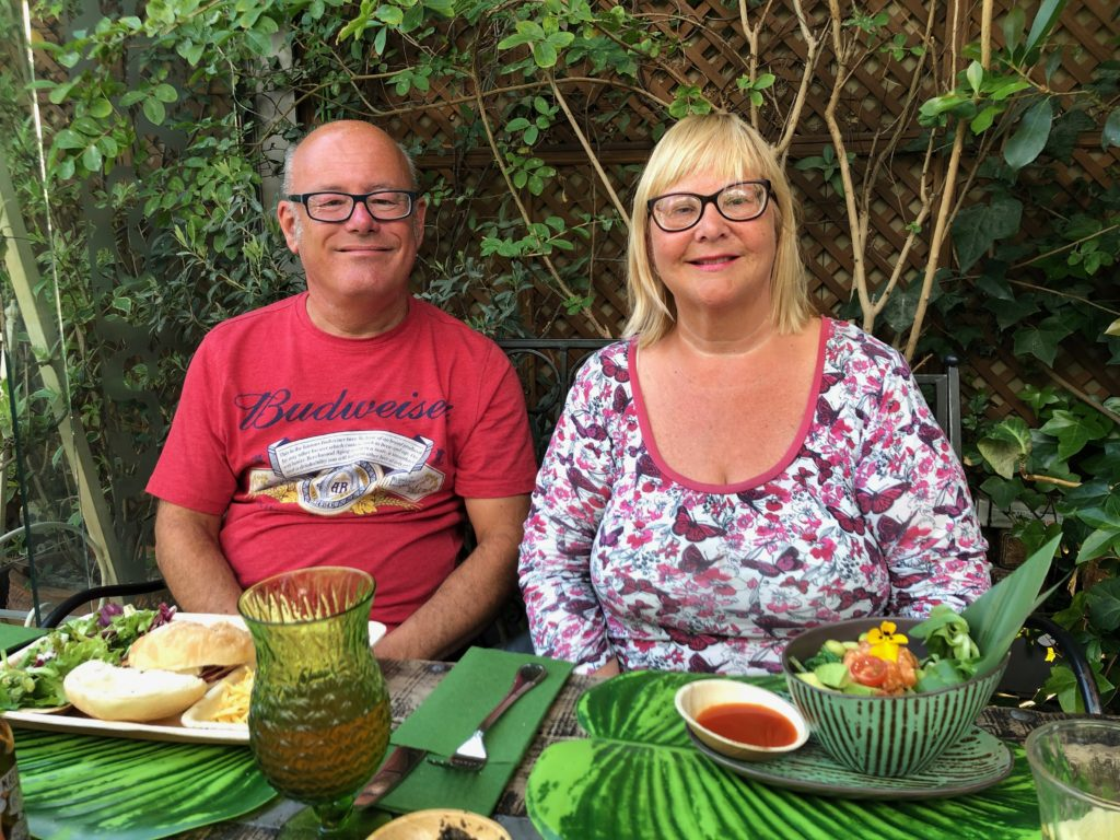 My auntie and uncle sit with their food at the Secret Garden.
