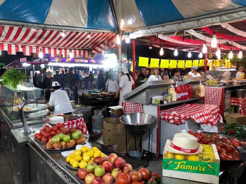 A festival catering scene full of fresh fruit.