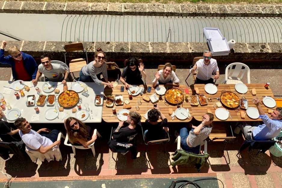 An arial shot of the team tucking into a paella lunch.