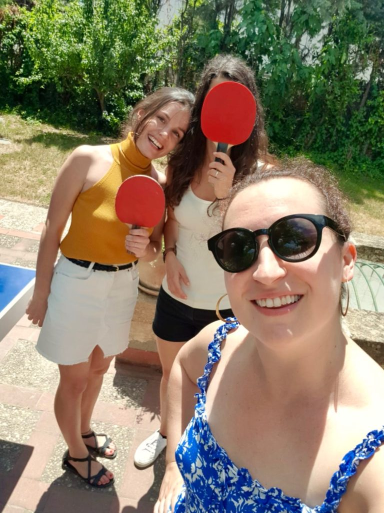 Heidi, Loredana, and Megan in my work's garden, ready to play ping pong.