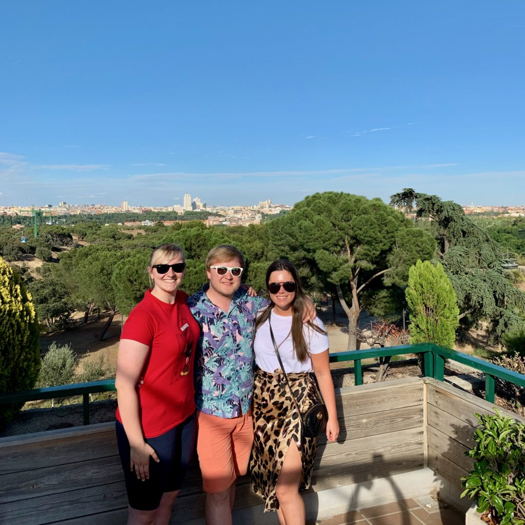 Danni, me, and Abi by the Casa de Campo Teleférico Station overlooking Madrid.