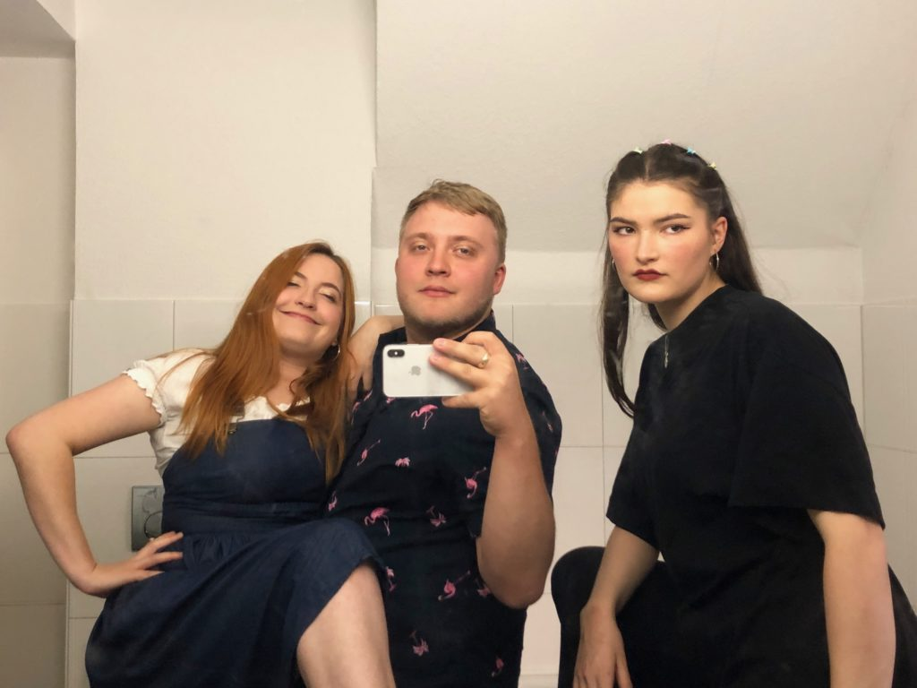 Luisa, Evie, and I take a group photo in the mirror before the beer festival.