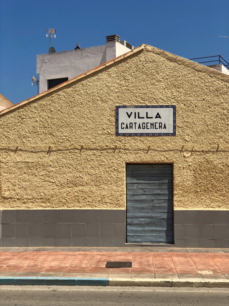 "An old building with the sign ""Villa Cartagenera""."