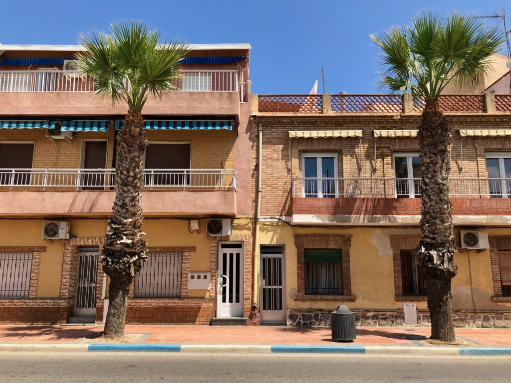 The facade of buildings near the coast in Murcia, Spain.