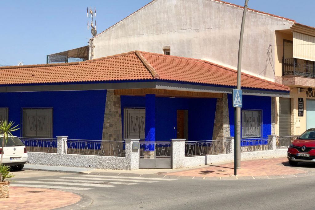 A vibrant blue building in a town in Murcia.