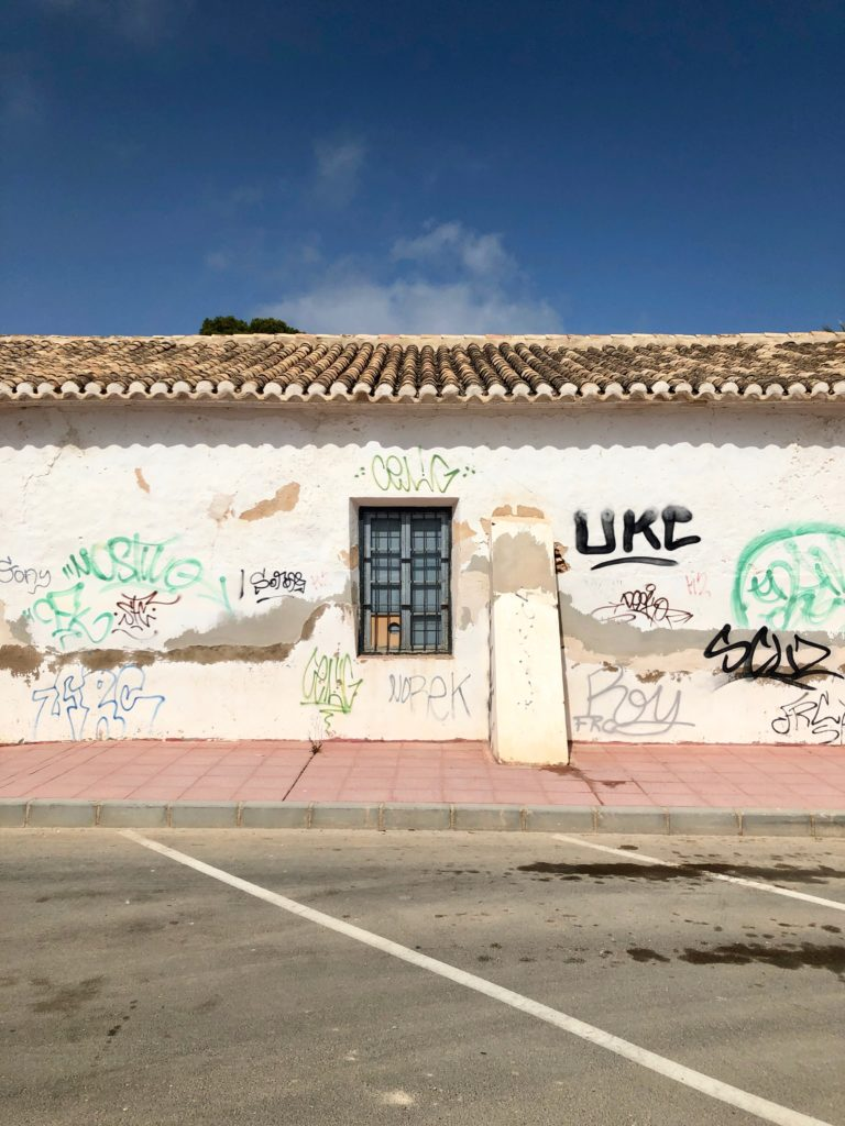 A graffitied wall in Murcia, Spain.