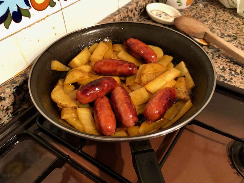 A frying pan full of chorizo and potato.