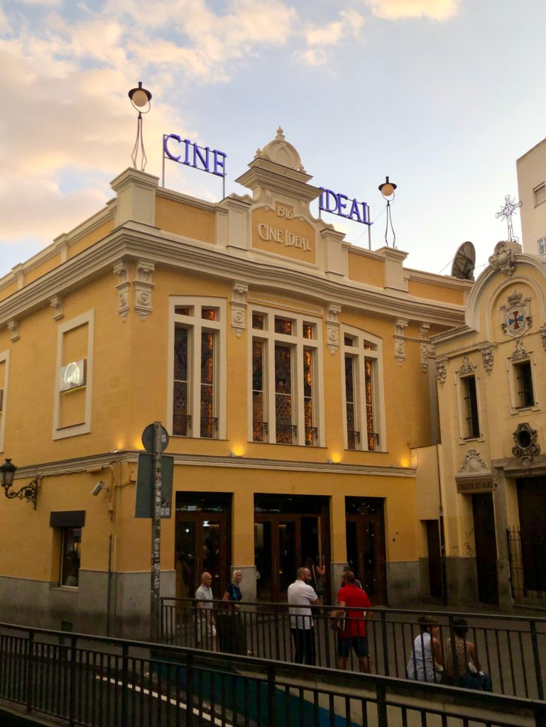 "The yellow facade of ""Cine Ideal"" in Madrid."