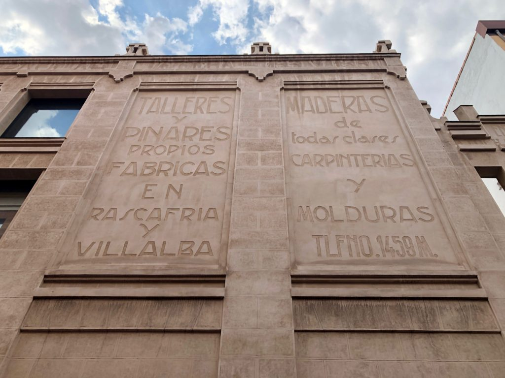Engraved text on the facade of a building in Madrid.