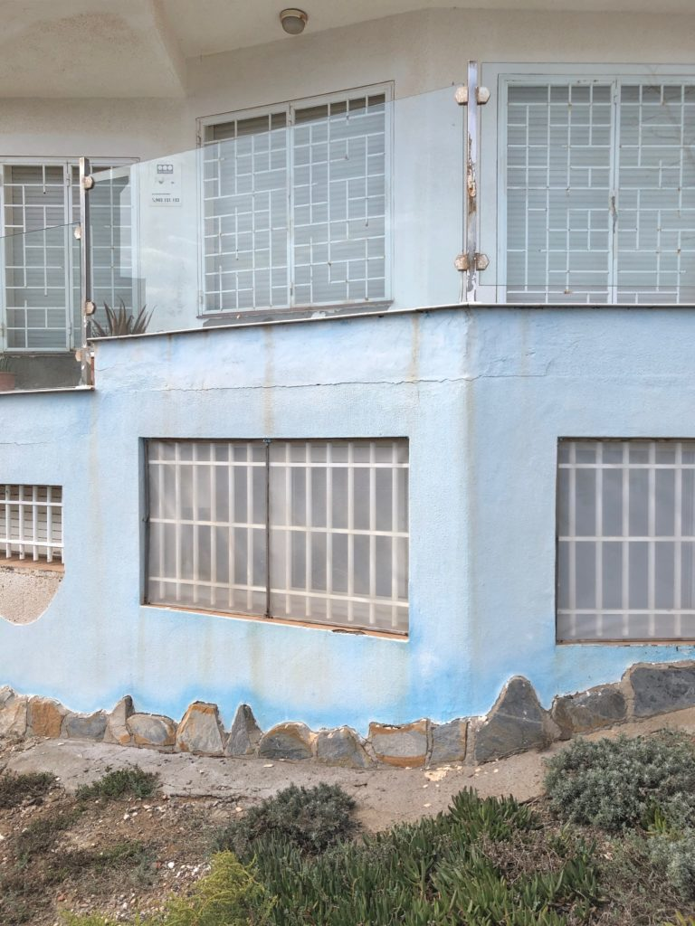 A sea-bleached blue house.