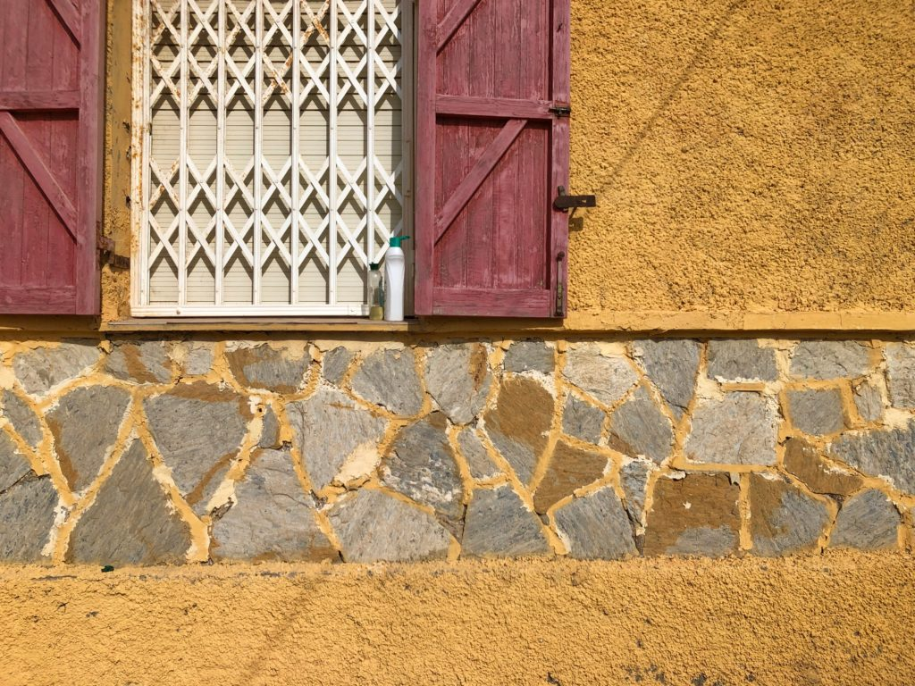Red shutters and yellow walls.