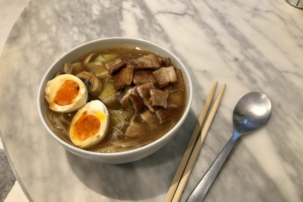 A bowl of pork ramen with egg.