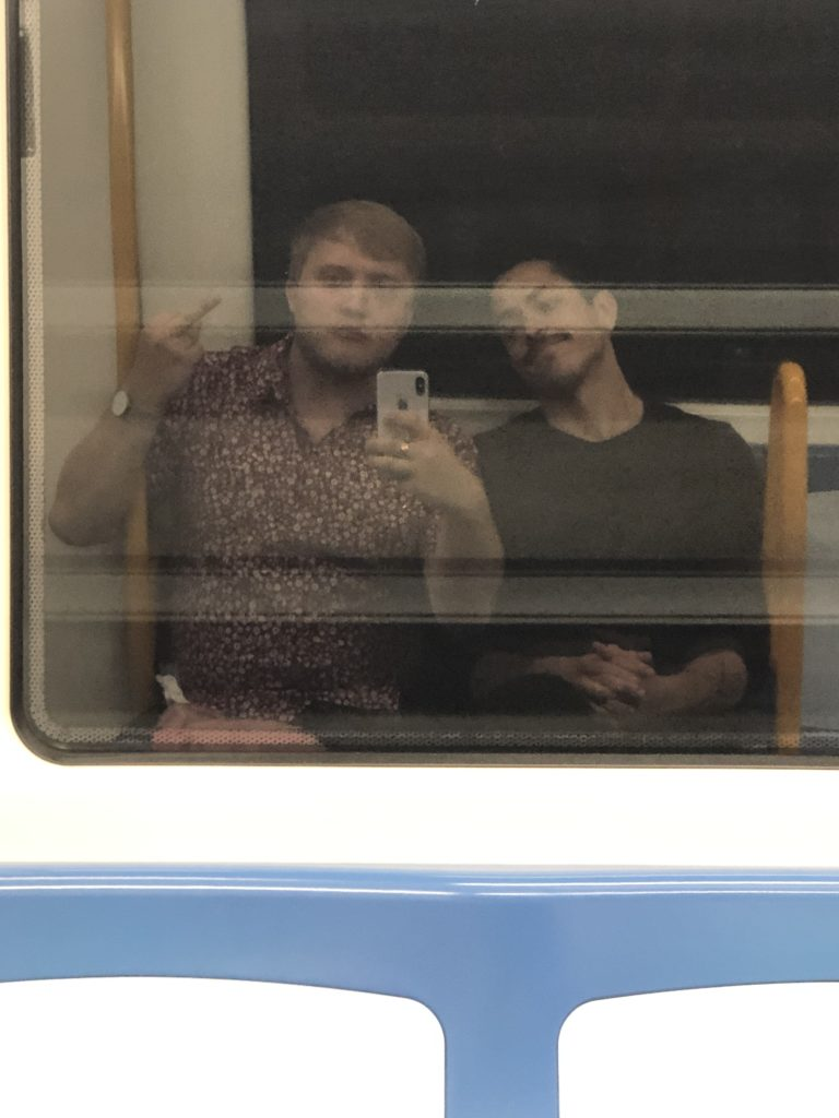 Me and Bogar in the reflection of a window on the metro.
