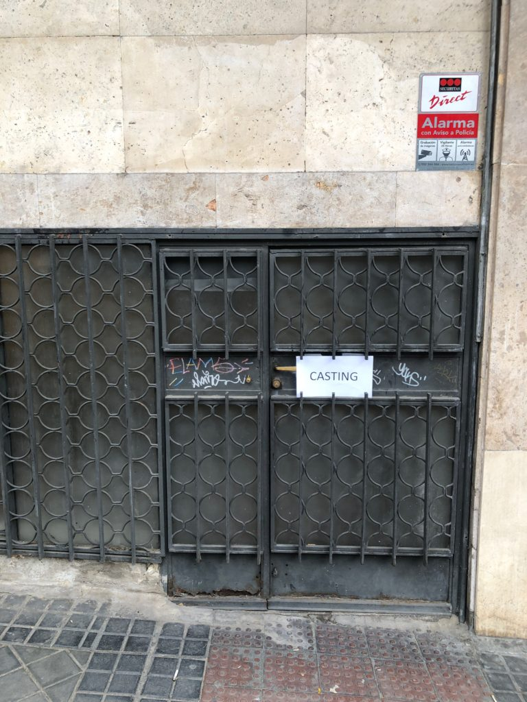 "A sign marked ""casting"" on a small iron door."