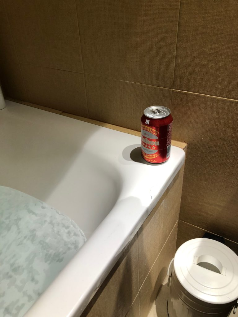 A bath with a beer.