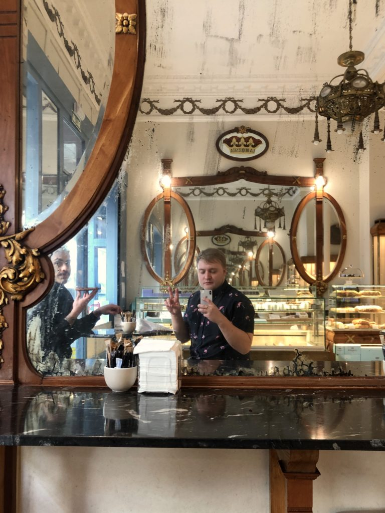 A selfie in the old mirrors of La Duquesita, a bakery in Madrid.