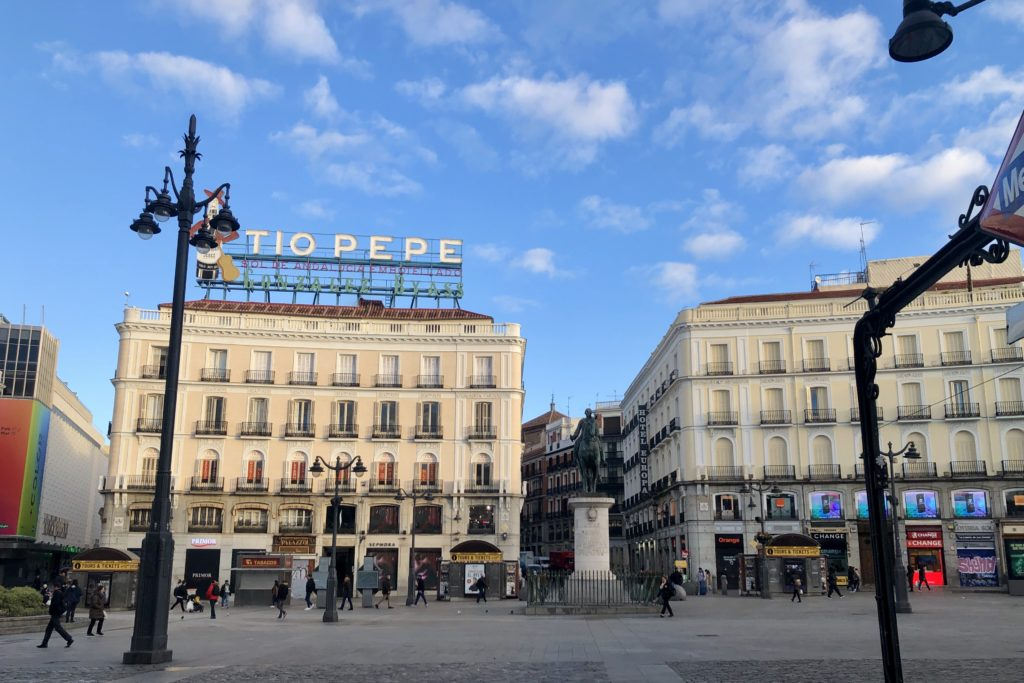La Puerta del Sol in Madrid, with the famous Tío Pepe neon sign.