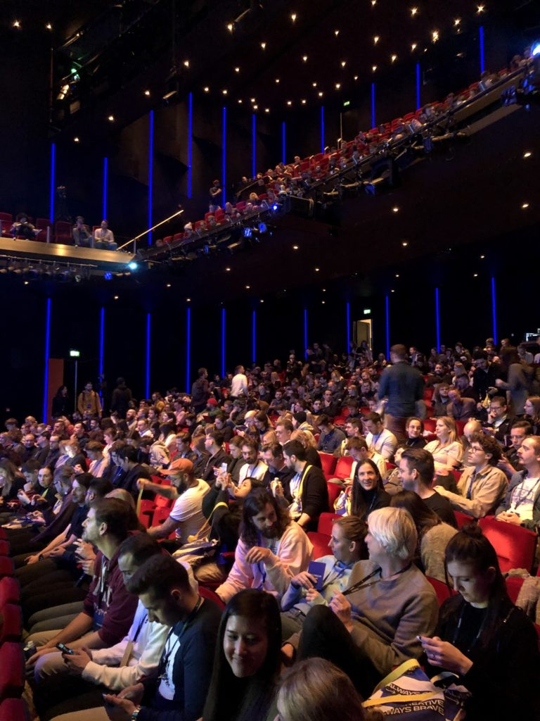 The auditorium of the DeLaMar theatre in Amsterdam is filled with attendees of the Awwwards Conference.