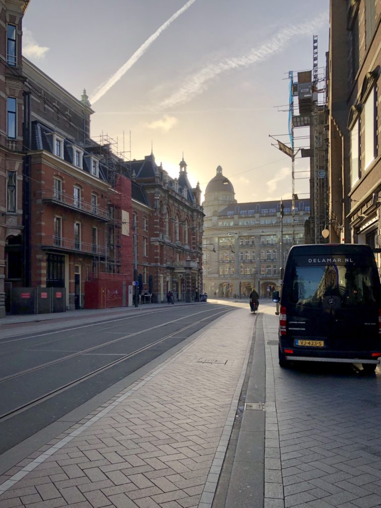 The sun rises over the streets of Amsterdam.