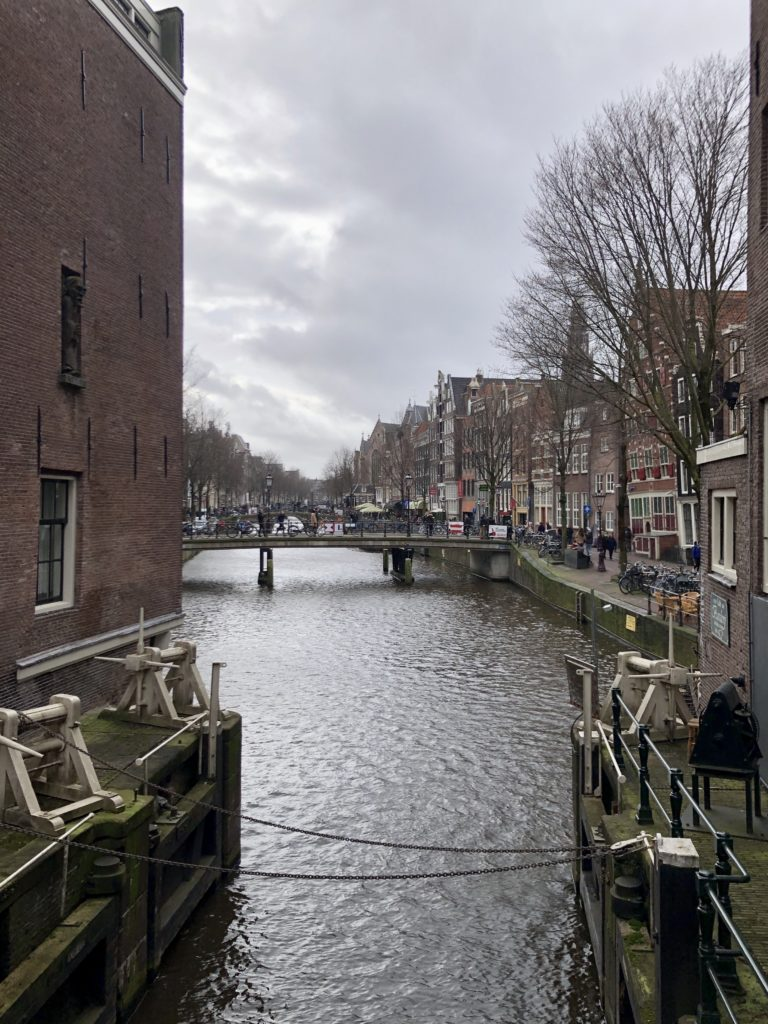 A canal winds through the streets of Amsterdam.