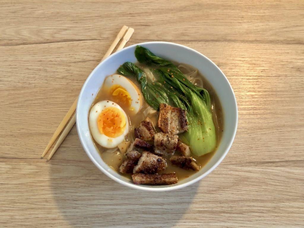 A bowl of homemade ramen with pork.
