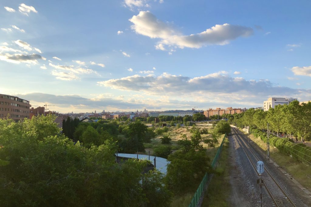 Clouds and blue sky over the city of Madrid as seen from a park in the south.