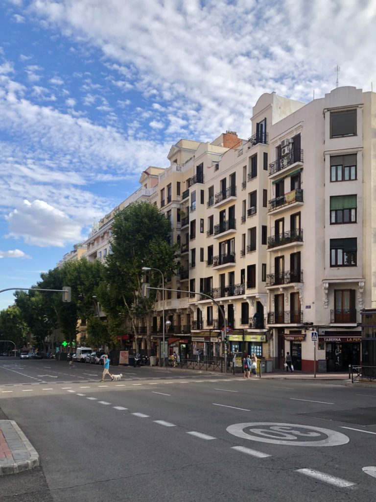 A street in Delicias, Madrid, covered by a sky with cloud formations.