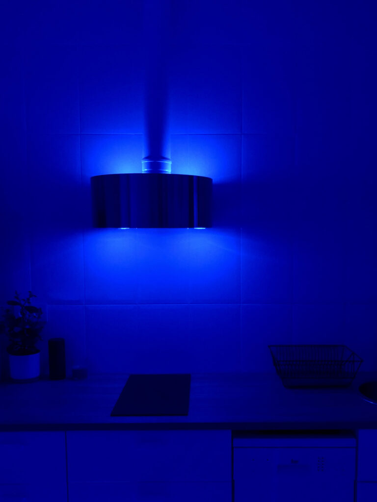 My house is illuminated in blue.