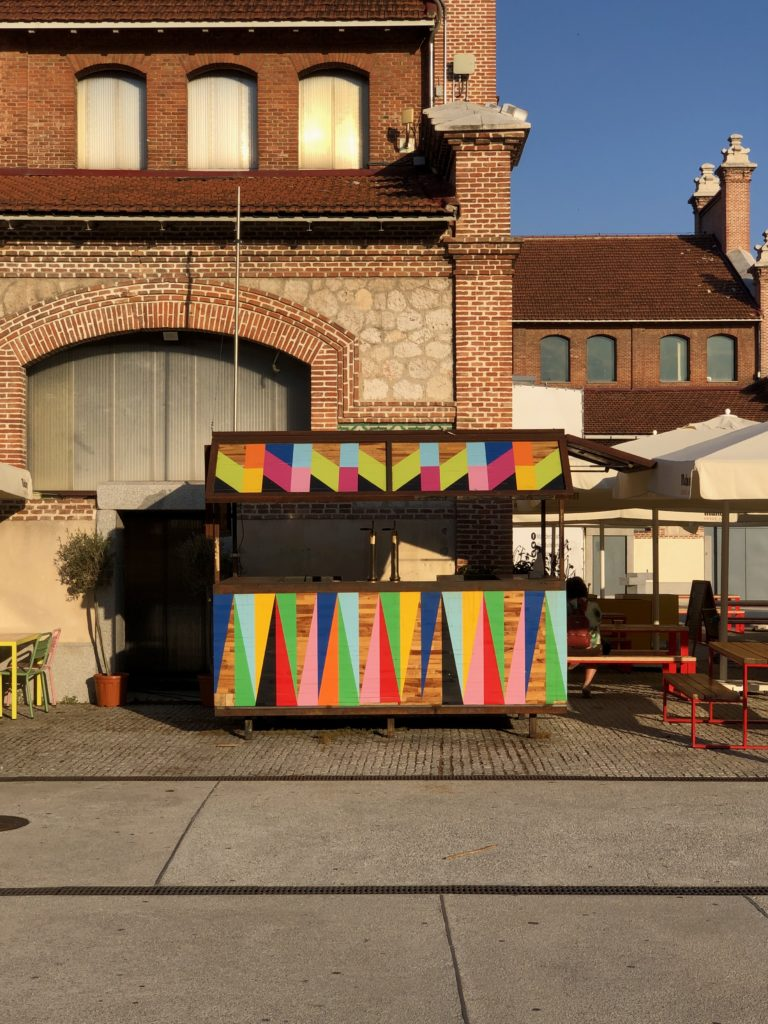 A multicoloured bar in a hut at the Matadero in Madrid.