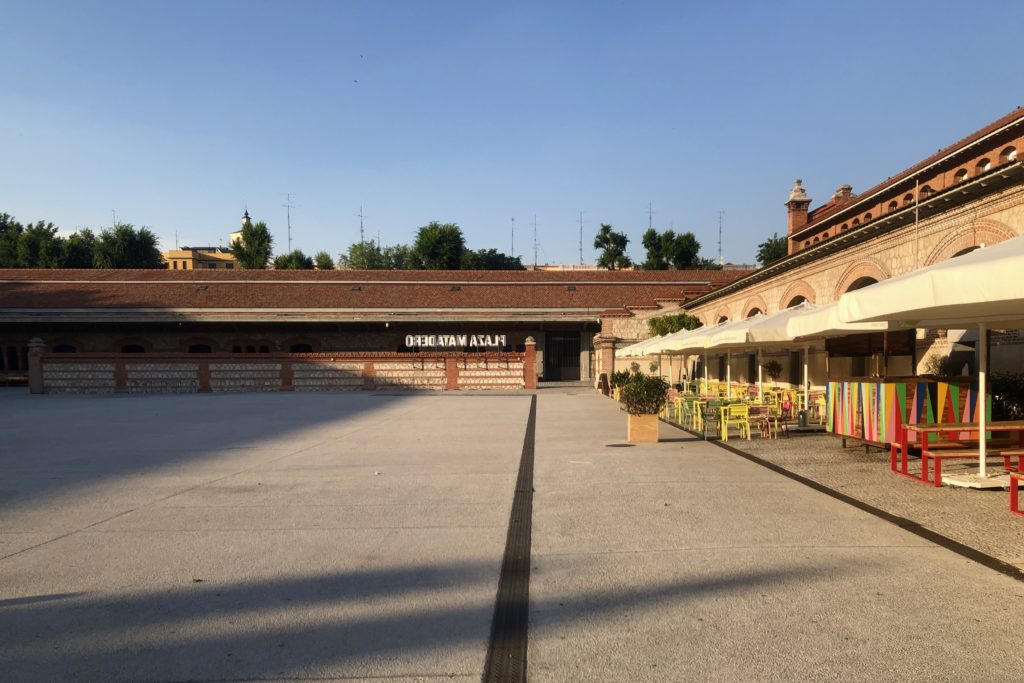 The plaza in the centre of the Matadero in Madrid is empty whilst bathed in the evening sun.