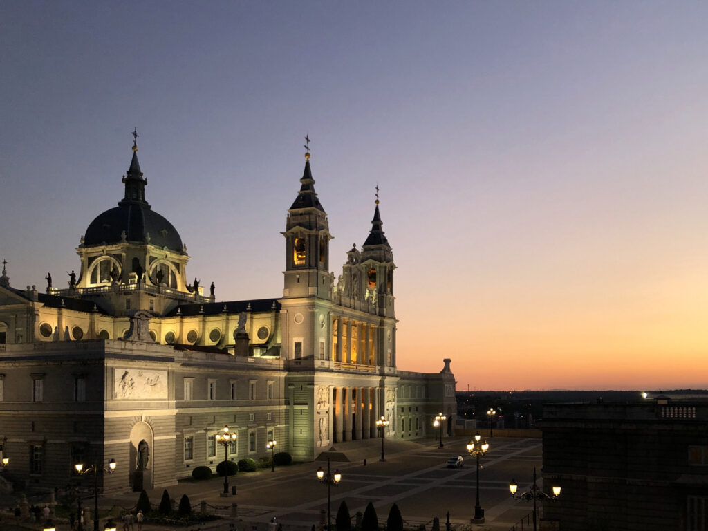 Madrid Cathedral lit up in the latter stages of a sunset.