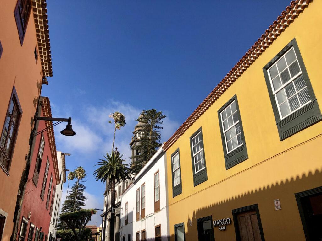 Brightly coloured facades line the street of La Laguna, Tenerife.
