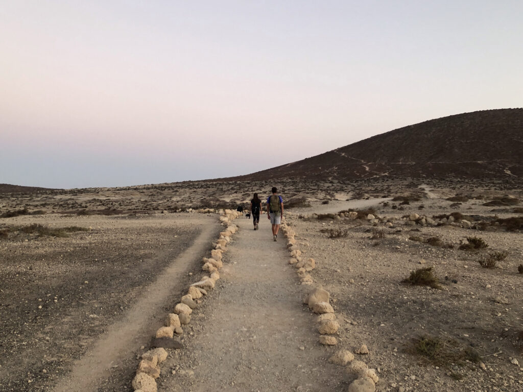 Cami and Sam walk towards the Montaña Rusa in Tenerife.